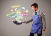 Man cooking vitamins and minerals — Stock Photo