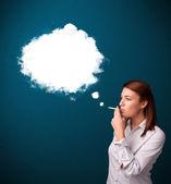 Young woman smoking unhealthy cigarette with dense smoke — Stock Photo