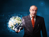 Businessman touching high-tech 3d earth panel — Stock Photo