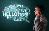 Young man making phone call with word cloud — Stock Photo