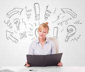 Attractive businesswoman brainstorming with drawn arrows and sym — Stock Photo