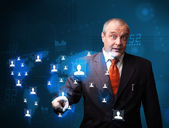Businessman choosing from social network map — Stock Photo