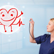 Attractive doctor with happy red smiling heart — Stock Photo #28432141