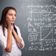 Beautiful school girl thinking about complex mathematical signs — Stock Photo #28431373