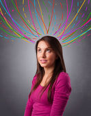 Young girl thinking with colorful abstract lines overhead — Stock Photo
