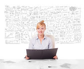 Pretty businesswoman planning and calculating various business i — Stock Photo
