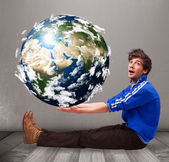 Good-looking man holding 3d planet earth — Stockfoto