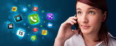 Young woman calling by phone with various icons — Stock Photo
