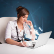 Pretty woman sitting at desk and typing on laptop with diagrams — Stock Photo #29315149