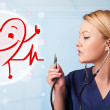 Attractive doctor with happy red smiling heart — Stock Photo #29315213