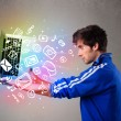 Casual man holding laptop with colorful hand drawn multimedia sy — Stock Photo