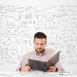 Businessman planning and calculating with various business ideas — Stockfoto