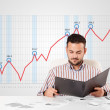 Businessman calculating stock market with rising graph in the ba — Stock Photo