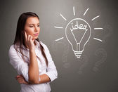 Young girl comming up with a light bubl idea sign — Stock Photo