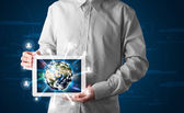 Businessman presenting 3d earth globe in tablet — Stock Photo