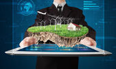 Businessman presenting a perfect ecology land with a house and w — Stock Photo