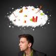 Businessman gesturing with cloud and charts concept — Stock Photo