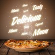 Stock Photo: Pizzwith delicious and tasty glowing writings
