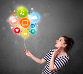 Woman holding social media balloon — Stock Photo