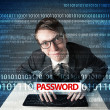 Young geek hacker stealing password — Stock Photo
