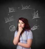 Young woman thinking with charts circulation around her head — Stock Photo
