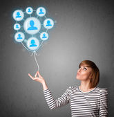 Woman holding social network balloon — Stock Photo