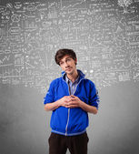 Young handsome guy with hand drawn calculations and icons — Stock Photo