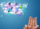 Happy smiley fingers looking at colorful magical clouds and ball — Stock Photo