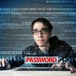 Young geek hacker stealing password — 图库照片