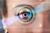 Cyber woman with technolgy eye looking — Stock Photo
