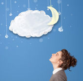 Young girl looking at cartoon night clouds with moon — Stock Photo