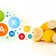 Healthy fruits with colorful vitamin symbols and icons — Stock Photo