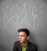 Businessman with arrows coming out of his head — Stock Photo