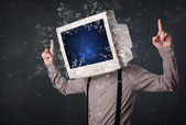 Computer monitor screen exploding on a young persons head — Stock Photo
