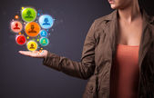 Social network icons in the hand of a woman — Stock Photo