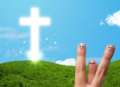Happy finger smileys with christian religion cross — Photo