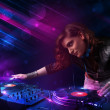 Young DJ playing on turntables with color light effects — Foto de Stock   #31139725