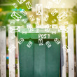 Mailbox with letter icons on glowing green background — Stockfoto