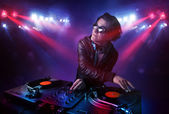 Teenager dj mixing records in front of a crowd on stage — Stock Photo
