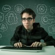 Young nerd hacker with virus and hacking thoughts — Stock Photo #31140227
