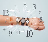 Hand with watch and numbers on the side comming out — Stock Photo