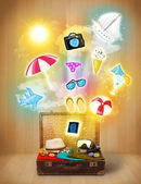 Tourist bag with colorful summer icons and symbols — Stock Photo