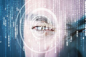 Modern cyber soldier with target matrix eye — Stock Photo
