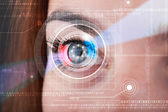 Cyber woman with technolgy eye looking — Stockfoto
