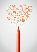 Crayon close-up with social media icons — Stockfoto