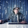 Hacker decoding information from futuristic network technology — Stock Photo #32026661