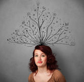 Young woman with tangled lines coming out of her head — ストック写真