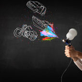 Man with airbrush spray paint with car, boat and motorcycle draw — Stock Photo