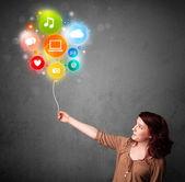 Woman holding social media balloon — Stock Photo