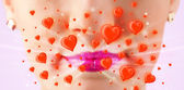 Pretty lady lips with lovely red hearts — Stock Photo
